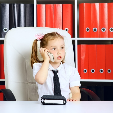 little girl as a businesswoman, in office