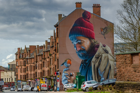 Foto de A gable end artwork by Simon Bates represents Mungo, Glasgow's patron saint, in modern day clothes. - Imagen libre de derechos