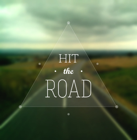 Hit the Road poster. Text in a triangle on a defocused road stretching to the horizon. EPS10 vector inage.