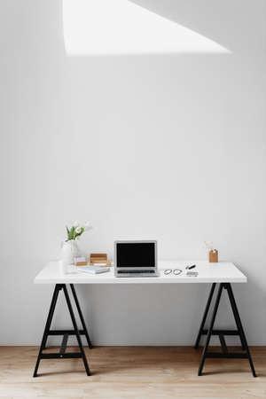 Photo pour Office desk top table with laptop and office supplies. - image libre de droit