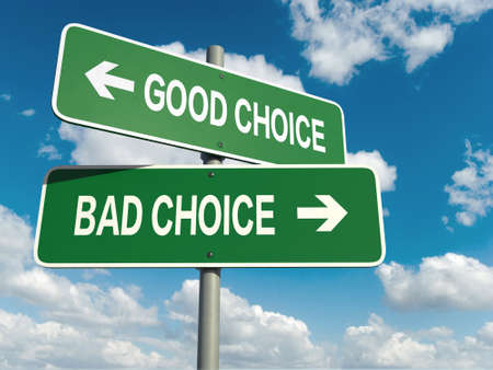 Foto de A road sign with good choice bad choice words on sky background - Imagen libre de derechos