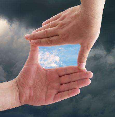 Photo for hands against a background of sky - Royalty Free Image