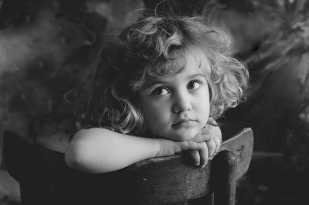Dreaming beautiful little girl, monochrome portrait
