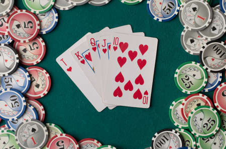 Cards on green felt casino table background.