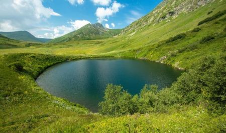 Russia. Sochi. Krasnaya Polyana. Caucasus Biosphere Reserve. View of the lake Maloe and mountain Perevalnaya.