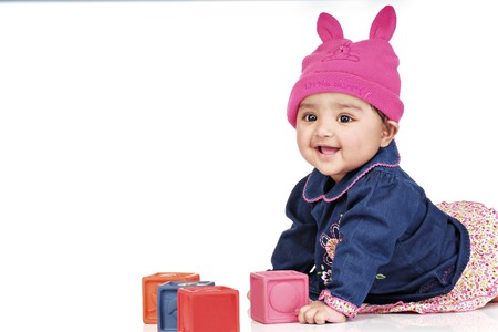 Photo for smiling baby girl playing with blocks lying on floor  - Royalty Free Image