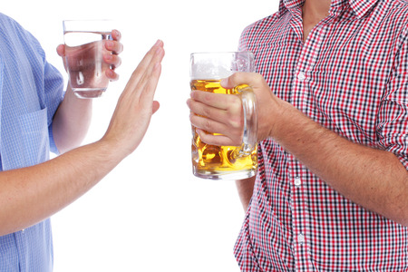 Two men with beer and mineral water