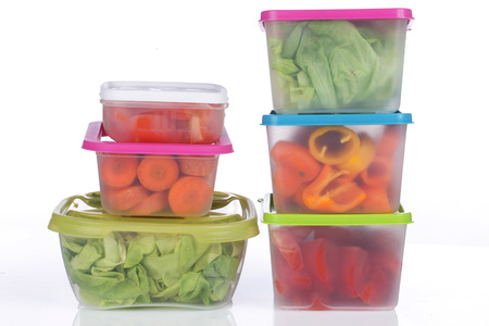 Photo pour Different platic boxes for storage with vegetables - image libre de droit