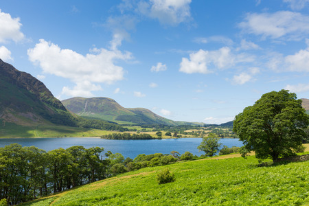 UK Lake District Crummock North West England UK between Buttermere and Loweswater on summer day with blue sky and white clouds