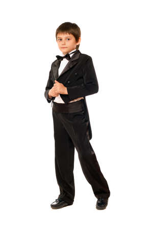 Little boy in a tuxedo. Isolated on white