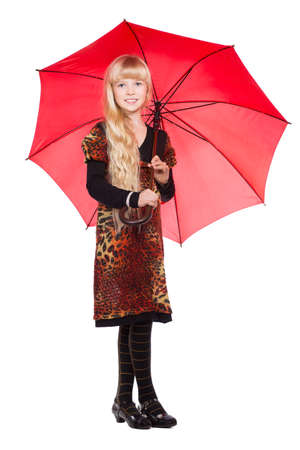 Little blond girl posing with red umbrella. Isolated on whiteの写真素材
