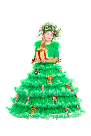 Little girl in green christmas dress posing with present. Isolated on white