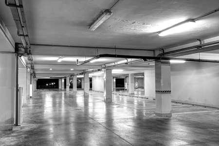 Underground garage. Empty underground parking garage