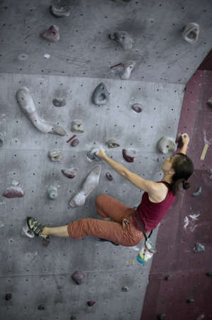 A girl doing her bouldering training