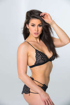 Photo for A gorgeous brunette model posing in lingerie in a studio environment - Royalty Free Image