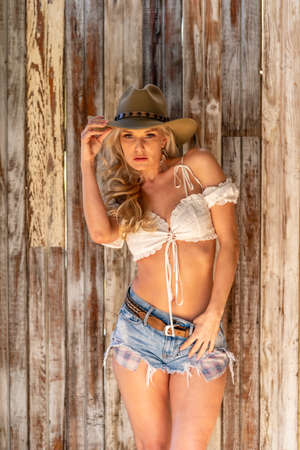 Photo for A gorgeous blonde model dressed as a cowgirl enjoying the outdoor weather - Royalty Free Image