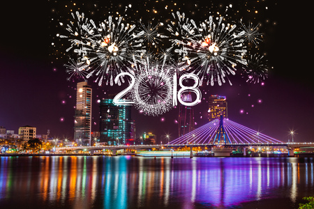 Photo pour Cheerful fireworks display in city night and bridge - image libre de droit