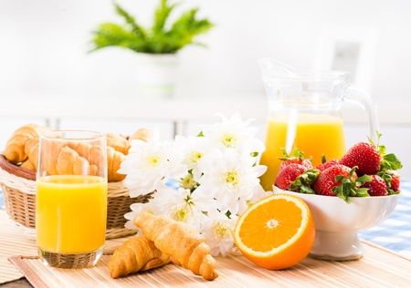 orange juice, croissants and strawberries