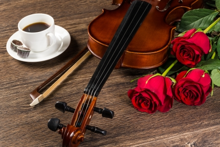 Violin, rose, cup of coffee and music books, still life