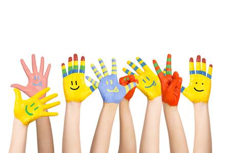 Photo pour painted children s hands in different colors with smilies - image libre de droit
