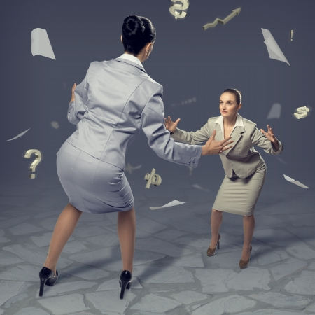 two businesswomen fighting as sumoists, the concept of competition in business