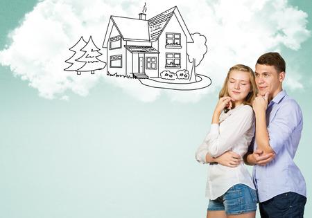 Photo pour Young happy family couple dreaming of future wealthy life - image libre de droit