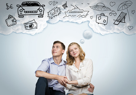 Photo pour Young happy family couple dreaming of future wealthy life - image libre de droit
