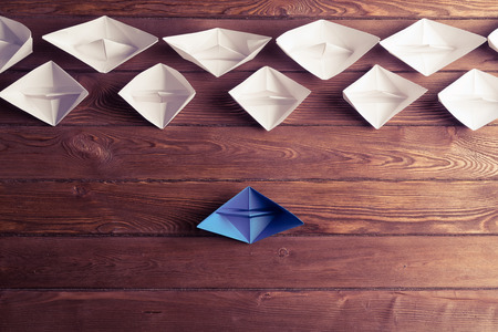 Photo for Set of origami boats on wooden table - Royalty Free Image