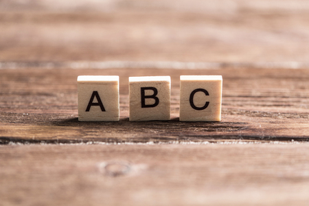 Foto de Alphabet letters on wooden pieces collected in word abc - Imagen libre de derechos