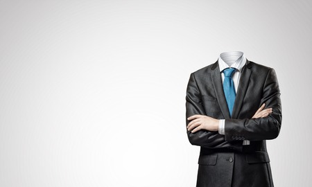 Foto de Headless businessman with arms crossed on chest in black suit - Imagen libre de derechos