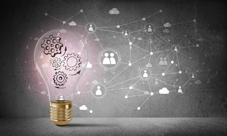 Photo pour Lightbulb with multiple sketched gears inside placed against social network system drawn on grey wall. 3D rendering. - image libre de droit
