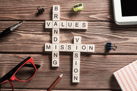 Photo pour Words of business marketing collected in crossword with wooden cubes - image libre de droit