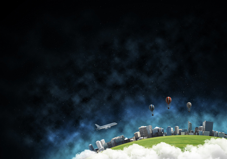 Photo pour Abstract panoramic view at planet Earth in clouds with buildings and aerostats from space. Dark space haze on background. - image libre de droit