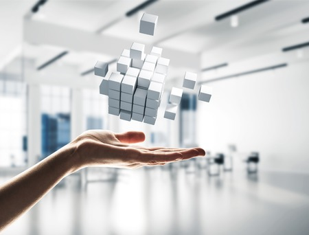 Photo pour Close of businessman hand holding cube figure as symbol of innovation. 3D rendering - image libre de droit