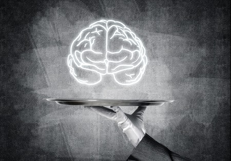 Photo for Cropped image of waitress's hand in white glove presenting sketched brains on metal tray with gray wall on background. 3D rendering. - Royalty Free Image