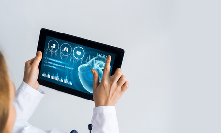Photo pour Tablet pc device with medicine interface screen in hands of doctor - image libre de droit