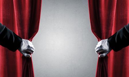 Photo pour Close up of hand in white glove open red velvet curtain - image libre de droit
