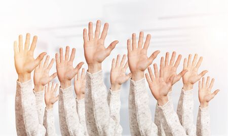 Photo pour Row of man hands showing five spread fingers gesture. Hello or help group of signs. Human hands gesturing on light blurred background. Many arms raised together and present popular gesture. - image libre de droit