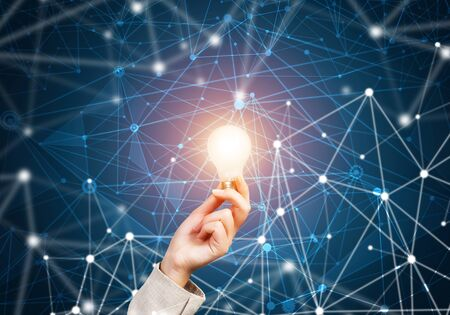 Photo pour Woman hand holding glowing light bulb and abstract network structure on background of dark wall. Science research and innovative solution. Global cloud technology and internet communication concept - image libre de droit