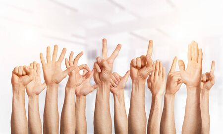 Photo pour Row of man hands showing various gestures. Ok, finger pointing, victory, spread fingers, clenched fist and thumb up signs. Human hands gesturing on light blurred background. Many arms raised together. - image libre de droit