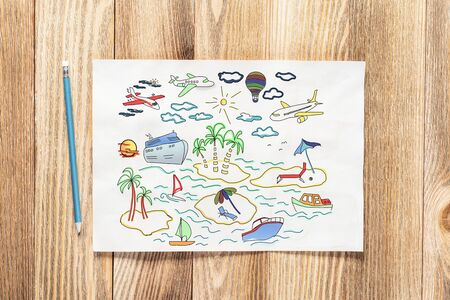 Foto de Summertime vacation at sea colorful pencil hand drawn with traveling doodles. Tropical recreatiation and ocean cruising symbols on white page. Top view of workplace with paper on wooden surface. - Imagen libre de derechos