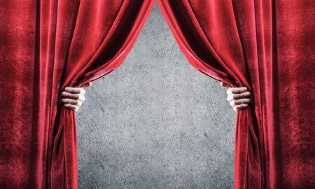 Photo pour Close up of businessman hand open red velvet curtain. Place your text - image libre de droit