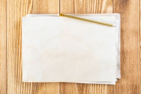 Photo for Sheet of paper lying on wooden table. Blank white a4 format paper with pencil. Textured natural wooden background. Vintage copy space for design. Business planning and idea generation. - Royalty Free Image
