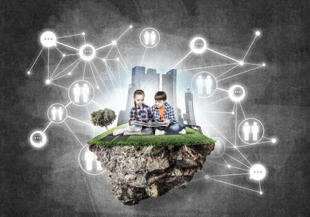 Photo for ECO concept floating island and children with book sitting on it - Royalty Free Image