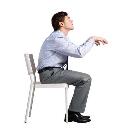 Photo pour businessman sits on a chair, plays an imaginary piano - image libre de droit