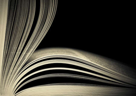 Photo for Close-up of opened book pages against black background. Space for text. Shallow DOF. - Royalty Free Image