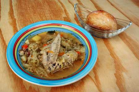 Polish traditional soup cabbage soup on a white background