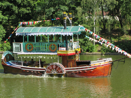 A small two-story boat for tourist walks along the river. Sofa is called