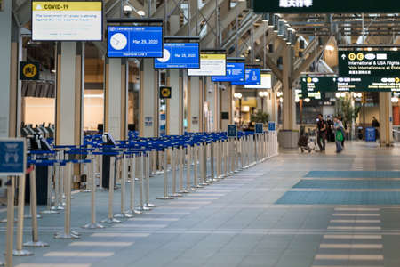 Photo for RICHMOND, BC, CANADA - MAR 29, 2020: International departures section of YVR which is nearly empty due to the COVID-19 coronavirus pandemic. - Royalty Free Image