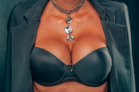 Photo pour Big Tanned Breasts Lady In Sexy Corset and necklace jewelry - image libre de droit